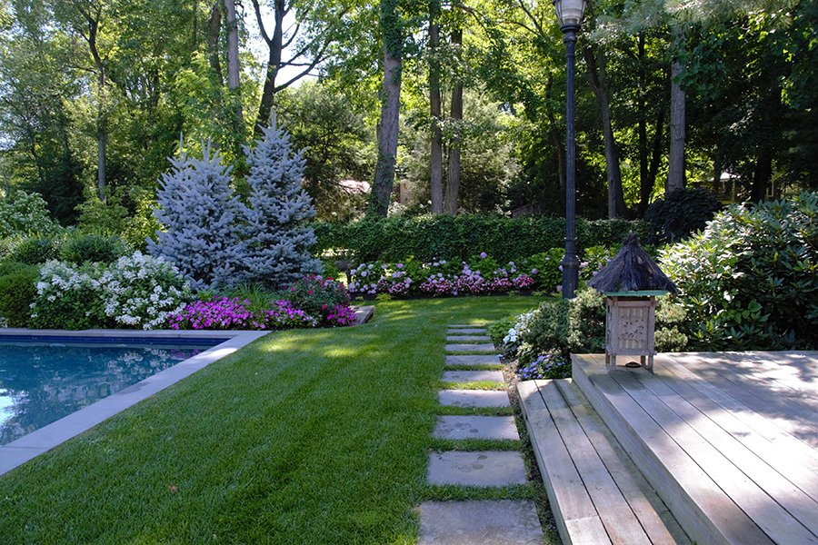Backyard Entryway with Colorful Planting Beds