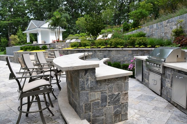 Custom outdoor kitchen design with stainless steel appliances