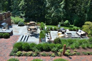 Layered patio levels, with outdoor dining and fire pit seating areas