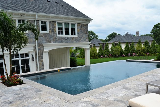 Raised Patio Area overlooking pool and lawn