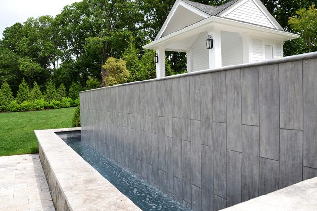 Sleek and Modern Spillway for Pool Design
