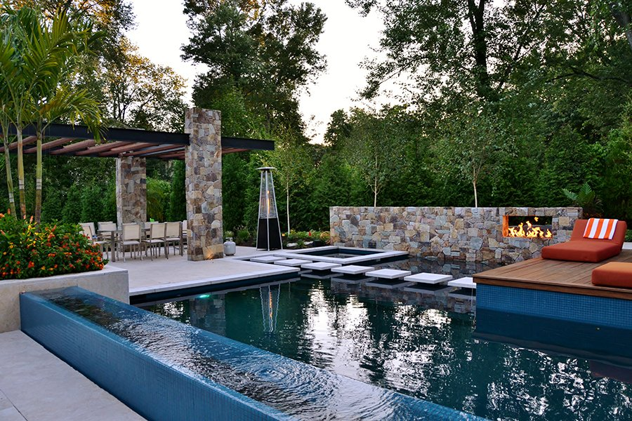 Custom Fire Feature in Stone Pool Wall
